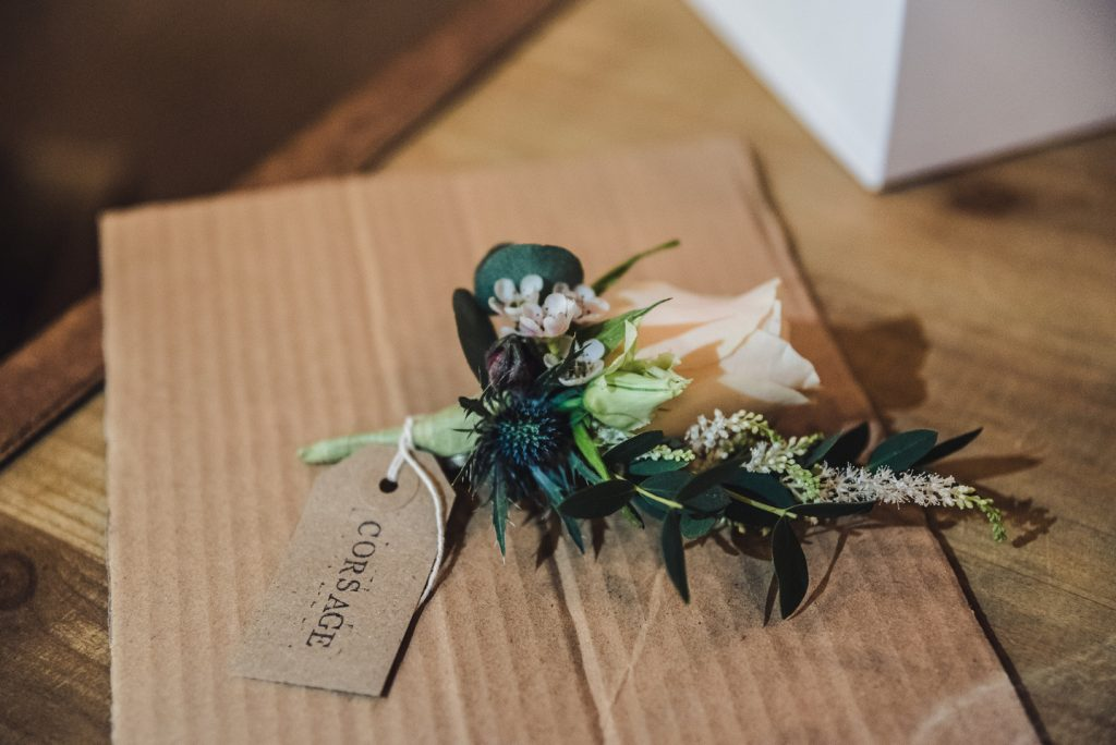 Lapel Corsage Wedding at The Mill Barns